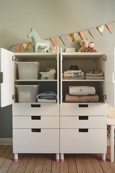 For nursery storage, we used the top shelves of cabinets for stuff like changing things like nappies and wipes, and the bottom ones for soft toys and blankets - things that are easy to pull out when baby starts crawling.