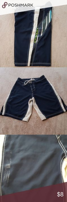 """Men's/Boy's Oakley Board Shorts. Sz. 28"""" Waist. Navy, white, gray, & blue board shorts with green Oakley logo. Logo on front right leg has worn off. See pic 3. No holes or stains but definitely in used condition. Waist size is 28"""". Oakley Swim"""