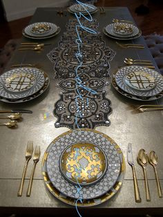 Table setting with Hermes Porcelain collection.