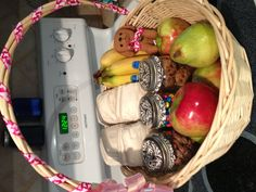 Gift basket for the new mom and dad! Fruit, nuts, chocolate, mini muffins and diapers!