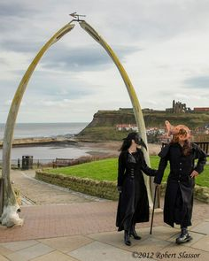 Karen and Rich of Grin, Grimace and Squeak!  in full costume by the whalebone arch in Whitby on halloween morning - goth heaven :)