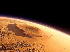 Olympus Mons is basically a large shield volcano on the planet Mars. It stands nearly 22 km (14 mi) tall, making Olympus Mons the tallest mountain on any planet in the Solar System. This mountain stands almost three times as tall as Mount Everest's height above sea level.