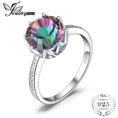 ~Metal: Silver with Rhodium EP (prevents tarnishing) ~Face Height: 6 mm x 10 mm Mystic Topaz Zircon ~Stone Shape: Baguette Cut ~Other Stones: 1 mm brilliant, clear CZs (x ~Sizes: 7 - 9 Comes in a free gift box. Pretty Outfits, Beautiful Outfits, Beautiful Gifts, Women Accessories, Clothing Accessories, Size Clothing, Fashion Photo, Fashion Group, Mystic Topaz