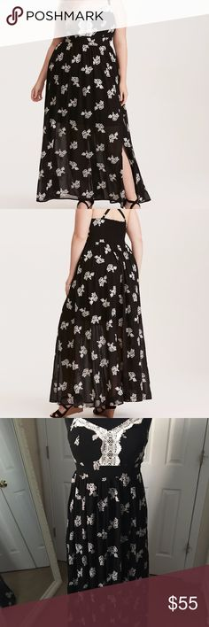 """Torrid Black & White Embroidered Challis Maxi 1X New with tags Torrid black & white floral embroidered challis maxi dress in a size 1 (1X - 14/16)--seen on a 2X dress form.  Wedding season is upon us ladies, and you'll definitely impress in this maxi. The side leg slit is the perfect amount of sexiness, while the crisscrossing adjustable straps and smocked back keep you comfy.  Polyester  ~60"""" from shoulder to hem, with adjustable straps torrid Dresses Maxi"""