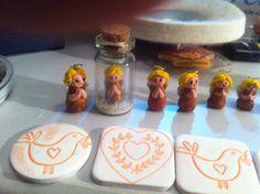 "Angels for little bottles. 1"" high."