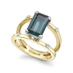 Emma Franklin sapphire engagement ring in rose gold with mink diamonds and baguette-cut diamonds.