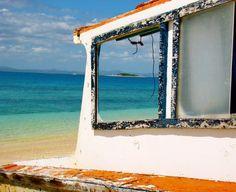 Rusty oceanside window.