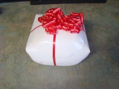 Using a milk jug to wrap a present...innovative idea and a great way to recycle plastic!
