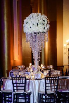 Floral Wedding Centerpieces Planning and Tips - Love It All Chandelier Centerpiece, Crystal Centerpieces, Bridal Shower Centerpieces, Flower Centerpieces, Chandelier Wedding, Metal Chandelier, Bling Wedding Centerpieces, Floral Chandelier, Centerpiece Ideas