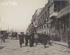 Merchants Walk on a Cobblestone Street in Izmir