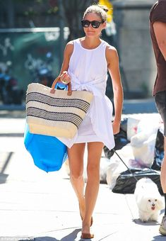 Laundry day: The socialite was seen carrying what appeared to be a bag of clean laundryl / MailOnline