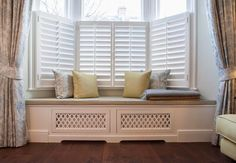 House of Turquoise: Lisette Voûte Designs. Love the window seat/radiator cover