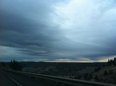 Dec 26, 2011 4:22pm. Somewhere near Prineville, OR. Very cloudy with just a peak of evening color.