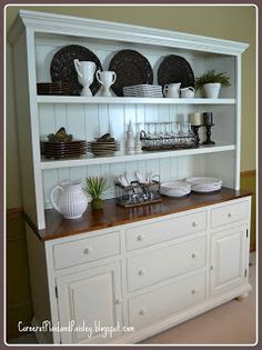 this woman had this hutch Amish made - love the layout, knobs, colors, crown - just would put glass doors on the upper two shelves - Corner of Plaid and Paisley