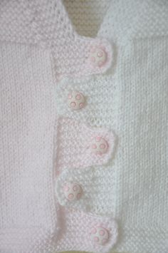 This is a hand knitted baby vest.  -Made out of wool yarn.  -Five pink-white buttons with ball.  -Fits for 6 to 18 months.  -Length is 27 cm / 10.6 Knitting Club, Knitting For Kids, Loom Knitting, Baby Knitting, Baby Vest, Baby Cardigan, Knitted Baby, Crochet Baby, Knit Crochet
