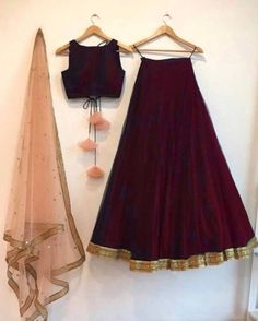 Wine silk lehenga choli set with a contrast embroidered peach/mint green dupatta. The lehenga choli is a custom made garment which include the blouse, lehenga(skirt) and the dupatta (stole). Skirt and blouse are in silk and stole material is net. It can be customised in any color of your choice.