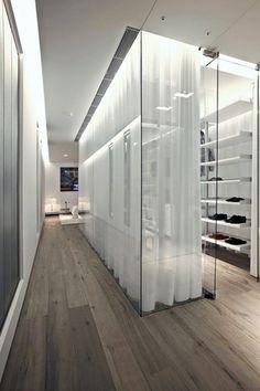 Contemporary Closet with Built-in bookshelf, Rustic taupe / oak / handscraped, specialty door, Hardwood floors