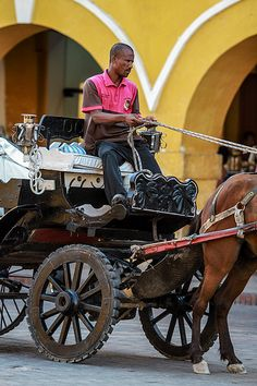 'Horse & Carriage taking tourists all over the historical centre of Cartagena de Indias, Colombia.'