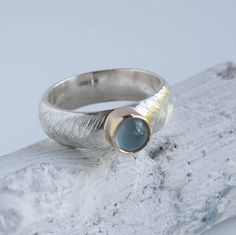 Aquamarine Silver And Gold Ring from notonthehighstreet.com