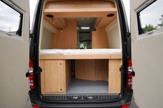 Rear view of the La Strada Regent S, a Mercedes Sprinter RV conversion. Typical Euro high rear bed layout allows it to be 1) always made and ready (no time/hassle making the bed) and 2) plenty of storage space underneath.