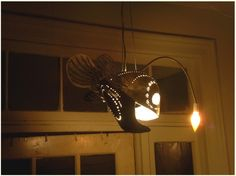 This anglerfish lamp pendant is so amazing that I'd make a nautical themed room just so I could use it.