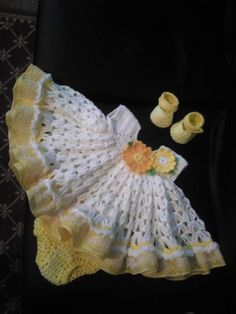 White crochet baby dress set with yellow gingham ruffles.