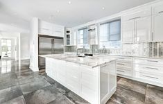 Kitchen with white painted high gloss cabinets quartz countertops polished concrete countertops Polished Concrete Countertops, Quartz Countertops, High Gloss Kitchen Cabinets, Modern Kitchen Design, Kitchen Designs, Painting Cabinets, Cabinet Design, White Paints, Townhouse