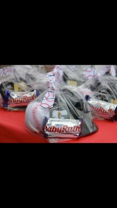 Party favors for a baseball-themed party: plastic helmet filled with baseball card, dog tag, soft ball & baby Ruth.