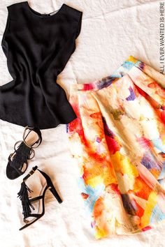 silky black top, colourful midi skirt , fringed suede sandals