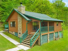 Honey Bear - 2 Bedroom - Not only is the location of this cabin rental great because you are near the parkway in Pigeon Forge and Dolly Parton Parkway in Sevierville it has lots of room outside and it is great place to take the kids on vacation. This cabin even has a high chair and baby crib! Bring your pet also! #petfriendly