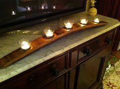 Wine stave candle holder. A coupla these will look great in our master bathroom. Will need to get some wine staves.