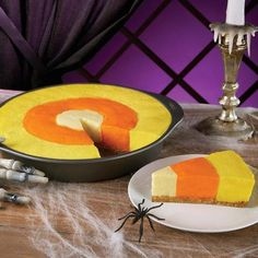 Candy Corn Cheesecake Ingredients: Orange Icing Color Lemon Yellow Icing Color Golden Yellow Icing Color 2 batches favorite no-bake cheesecake recipe Checkboard cake divider ring Directions: Prepare 2...