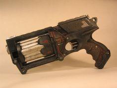 http://fc09.deviantart.net/fs71/i/2010/078/3/9/Ebony__A_Dieselpunk_gun_Left_by_EricTcrow.jpg