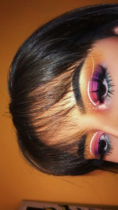 Neon eye looks! Featuring a bit of hot pink, orange, blue eyeshadow and white liner. Love this unique beauty look