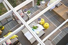 The seating area of a beautifully decorated backyard deck