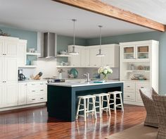 Pinning for the combination of the honey wood floors & beam, and the light coloured cabinets.