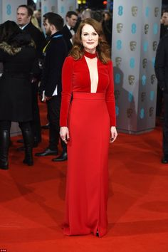 Ravishing in red: Julianne Moore wowed the crowd as she arrived at the EE British Film Aca...
