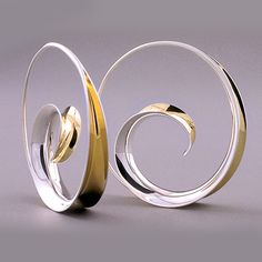 Contemporary Hoop Earrings made of Sterling Silver and 18K Yellow Gold Bimetal by the Anticlastic Raising technique. Hammered and buffed to a high polish. By Nancy Linkin