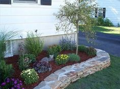 How to Landscape a Flower Bed - low maintenance- I like the rock boarder. Cute idea.