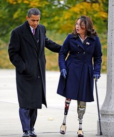 President Barack Obama walks with Gulf War Veteran Tammy Duckworth, who lost both her legs in combat. Obama joined Duckworth at the Bronze Soldiers Memorial in Chicago for Veteran's Day 2008.