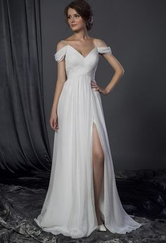 Style #50150024 draping off the shoulder wedding gown with leg slit