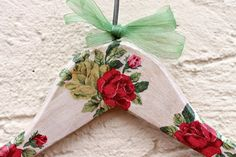 Shabby chic wooden hanger decorated with red roses