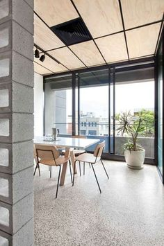 Ceiling - ply and black, concrete floor, concrete block screen and hardy plant. Nice. Blackwood Street Bunker by Clare Cousins Architects / Shared Office Space in Melbourne