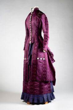 Purple velvet-figured and watered silk two-piece dress, 1884. The tightly fitted bodice has encased boning; it buttons down the front with 18 steel-studded pearl buttons. The back bustle with puffed drapery creates the proper silhouette. This dress was made by Mrs. Harriet Theresa Barrington Randall for her daughter, Caroline Amelia (1861-1944) to wear when she married William Rush Kelly in Blackville, SC on January 2, 1884. The Charleston Museum
