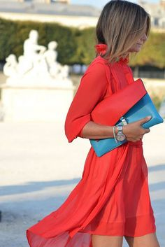 Glamour Obsession: French, do it Better via la dolce vita. A French woman spices things up with a flowy little red number and a bold blue clutch.