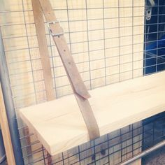grid walls for craft shows - interesting way to hold up a shelf using a belt