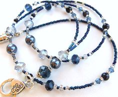 MIDNIGHT OCEAN- Glass Beaded Id Lanyard and Badge Holder- Ink Blue Crystals and Pearls, and Blue Sandstone Beads (Magnetic Clasp). $22.00, via Etsy.