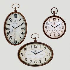Chantal Oval Horizontal Iron Clock - Love the look of all three clocks on the wall..