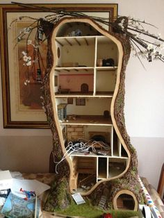 this woman made a doll house in a tree shape and here's HOW she did it! I was thinking what a cool storage item this could be or a yard decoration--SOMETHING! ANYTHING!  I just want one for myself!