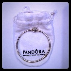 Pandora Bracelet  Crafted of sterling silver, this PANDORA fashion jewelry charm bracelet measures 7.5 inches in length. More pictures available upon request.  Worn a handful of times, it's too small for my wrist.  Dust bag included. Pandora Jewelry Bracelets